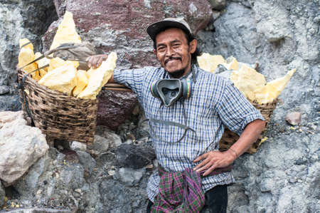 Portrait of a worker at Ijen crater, a sulfur mine in Java, Indonesia