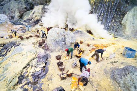 Workers at Ijen volcano in Java, Indonesia collecting sulphur