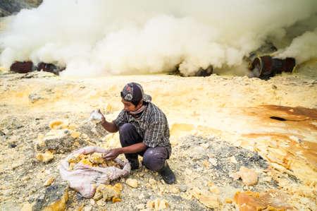 Worker at gunung Ijen in Java, Indonesia collecting sulfur