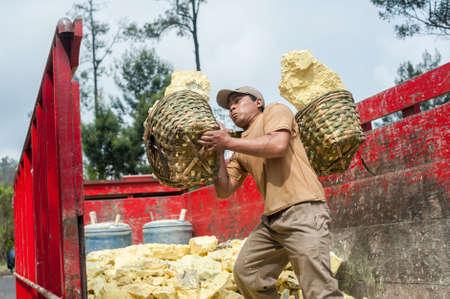 Worker at Kawah Ijen sulphur mine brings his sulphur to the truck