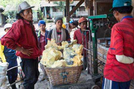 Workers at Ijen crater at the weigh station