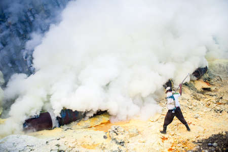 A worker at gunung Ijen in East Java, Indonesia mining sulfur