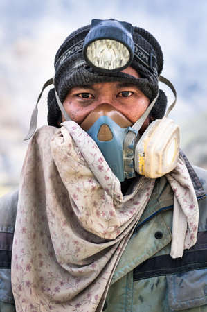 Portrait of a worker at Ijen Crater in East Java, Indonesia Editorial