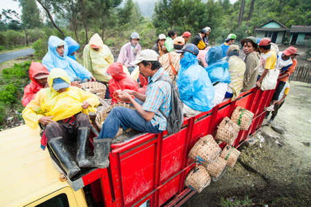 Workers at Ijen crater go home together in a truck after work