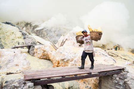 indo: Worker at Kawah Ijen in Java, Indonesia carries sulfur