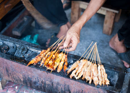 Grilling traditional Indonesian satay chicken satay ayam