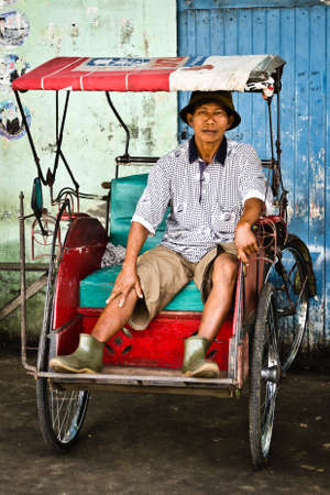 Bicycle taxi driver in Pontianak, Kalimantan, Indonesia Editorial