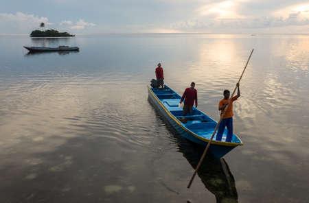Banda Islands, Indonesia - February 2, 2013: Early morning boat yearlings Hatta island.
