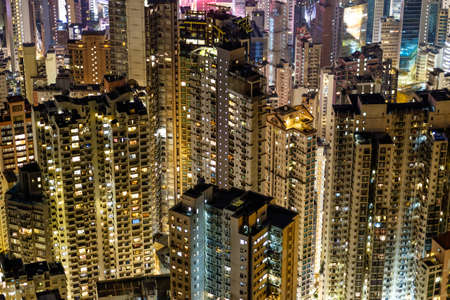 wan: Hong Kong apartment buildings at night. Central district, view from Victoria Peak.