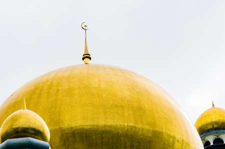 domes: Golden domes of a mosque in Brunei