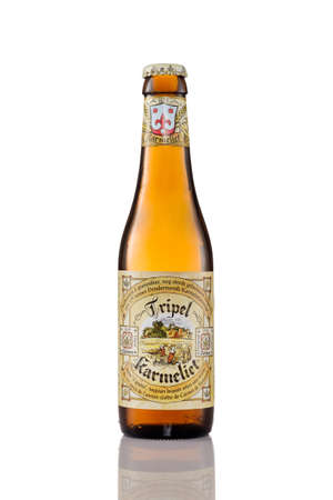 A bottle of Tripel Karmeliet beer isolated on a white background. Tripel Karmeliet is a Belgian beer first brewed in 1996, based on a recipe from 1679 which used wheat, oat and barley.