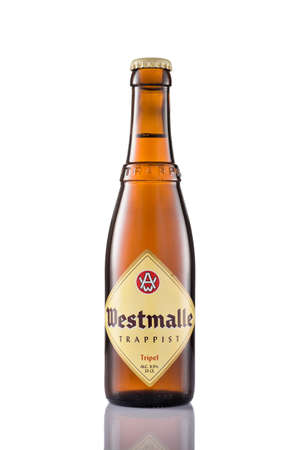 A bottle of Westmalle Tripel Trappist isolated on a white background. Westmalle is a famous Trappist beer from Belgium.