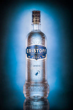 Bottle of Eristoff vodka on a dark background with blue spot. Eristoff Vodka originated from Georgia and was first created for Prince Eristavi in 1806.