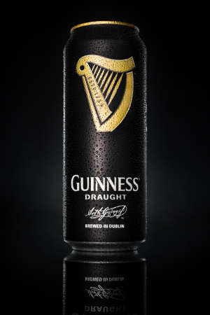 Guinness draught can on black background. Guinness is a popular Irish dry stout and one of the most succesful beers in the world. Editorial