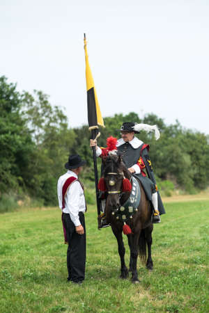 guild: CASTEREN, THE NETHERLANDS - JULY 5, 2015: Two members of a traditional Dutch guild on Free Guild Day. Editorial