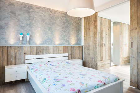 Modern bright bedroom whit a loot of wood