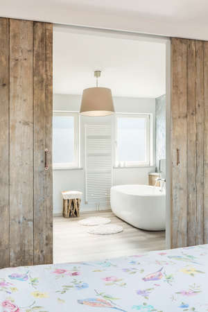 a detached living room: Modern bright bathroom and bathroom with seperate bath Stock Photo