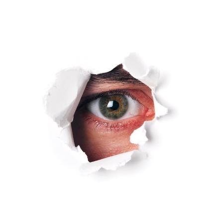 eye hole: Spy eye watching through a hole isolated Stock Photo