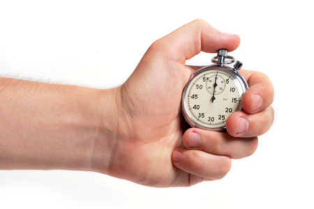 Mans hand holding stopwatch, isolated on the white background Stock Photo