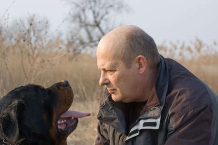 man and rottweiler dog face to face Stock Photo - 1180517