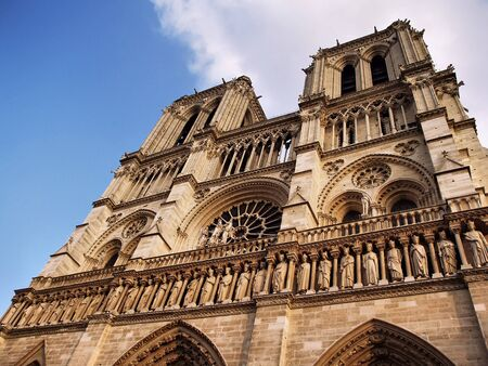 Notre Dame cathedral in Paris against blue sky.