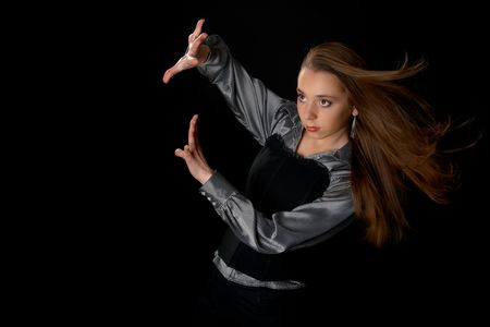 Young girl  defends by ones arm from wind in dark Stock Photo