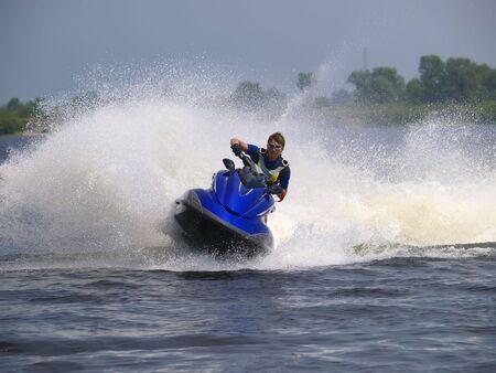 jetski: Man on WaveRunner rides very fast with much splashes