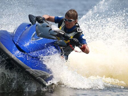 jetski: Man on WaveRunner turns very fast