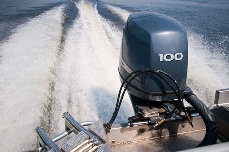 motor boat: Outboard motor marked by a fiery wake