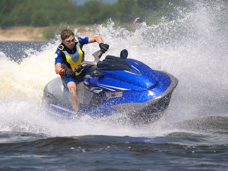 Man on Wave Runner turns fast  on the water Stock Photo