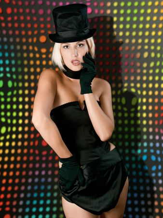 Cabaret  show girl in black combination against an abstract multicolour background