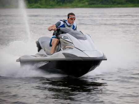 Man on Wave Runner skims along very fast