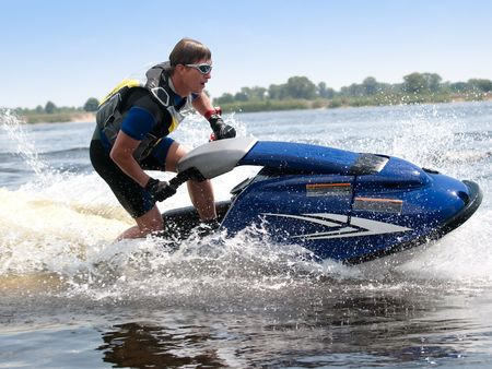 Man on jet ski rides very close Stock Photo