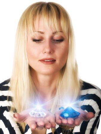Young woman looks on glaring diamonds. photo