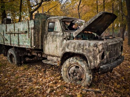 Woman like a driver in old neglected broken car Stock Photo - 6638506