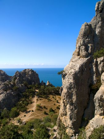 View from mountains to sea and blue sky photo