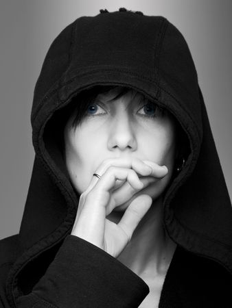 Black & white studio shot of thoughtful woman in hood with blue eyes Stock Photo - 6638534