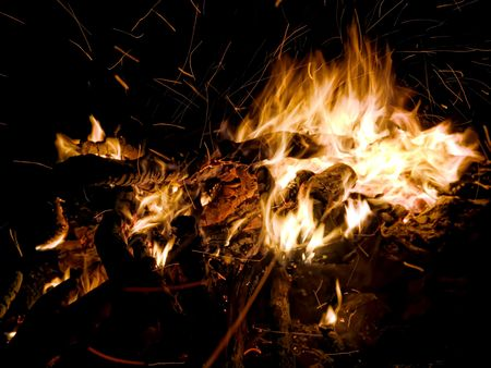 Nature campfire with flying sparks and firewood Stock Photo