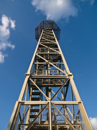 Parachute tower against a blue sky Stock Photo