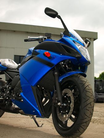 Front part of new sportbike outdoor against a cloudy sky Stock Photo - 7163564