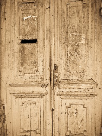 door bolt: Old closed grunge door in terrible conditions Stock Photo