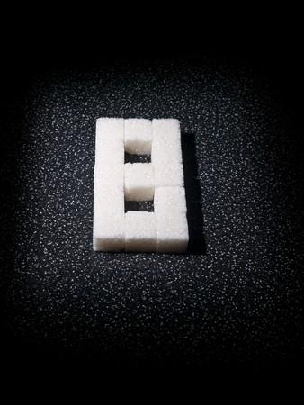 eighth: Digit eighth built from lumps sugar in dark tone