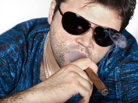 Man smokes a cigar like a gangster Stock Photo - 7420663