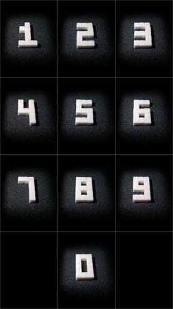 Collage of digits from 1 to 0 which are built from lumps sugar in dark tone photo