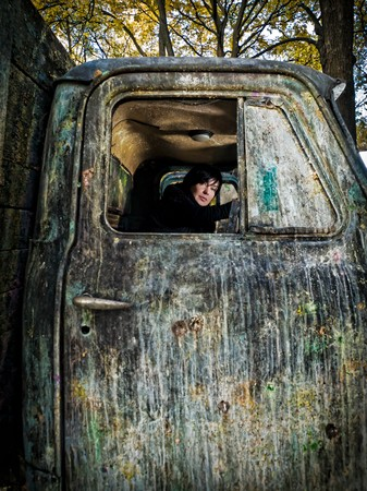 autotruck: Woman like a driver in old dirty truck