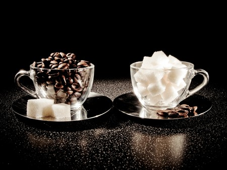 Two cups with coffee beans and sugar photo