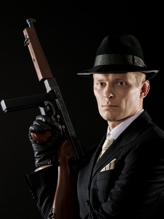 Man like a chicago gangster with Thompson submachine gun Stock Photo