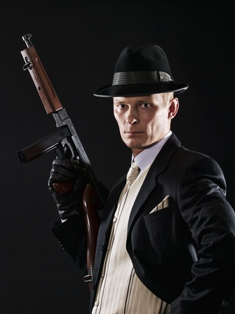 Man like a chicago gangster in suit with Thompson submachine gun photo