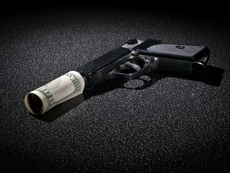 Handgun with imitation of silencer from dollar greenback Stock Photo