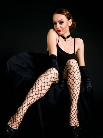 ruby red lips and black openwork stockings photo